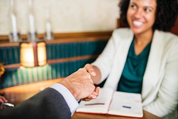 businesswoman-collaboration-congratulating-1571150